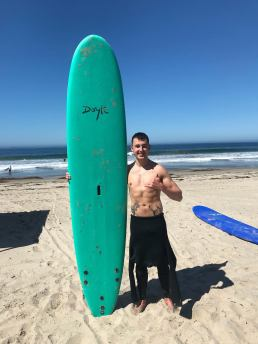 James and a surfboard