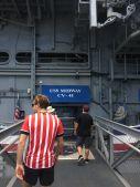 Glenn boarding the USS Midway