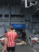 Glenn boarding the USS Midway